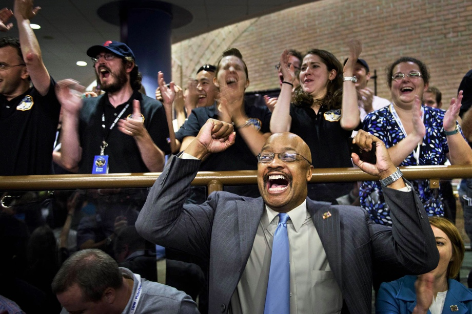 NASA staff react to Pluto probe